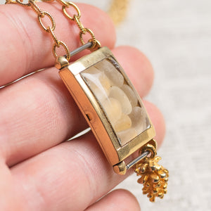 Assemblage Necklace of Vintage Wrist Watch filled w/ White Sea Glass & Gold Pine Cone Charm