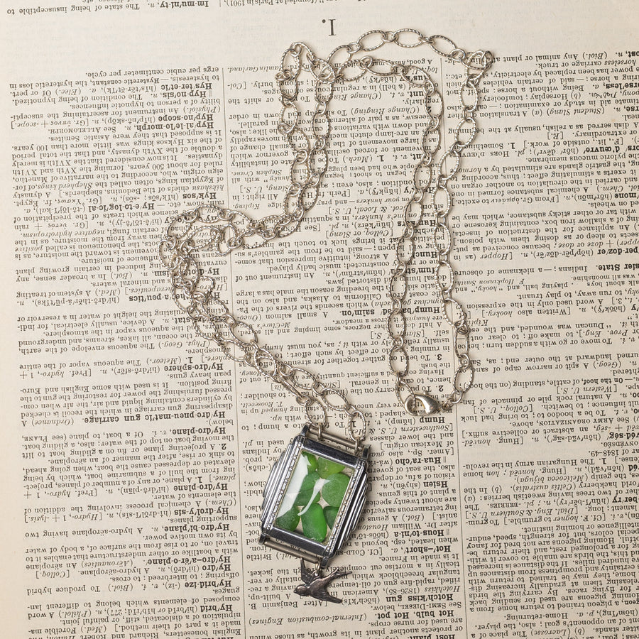 Assemblage Necklace of Vintage Wrist Watch filled w/ Green Sea Glass & Bird Charm