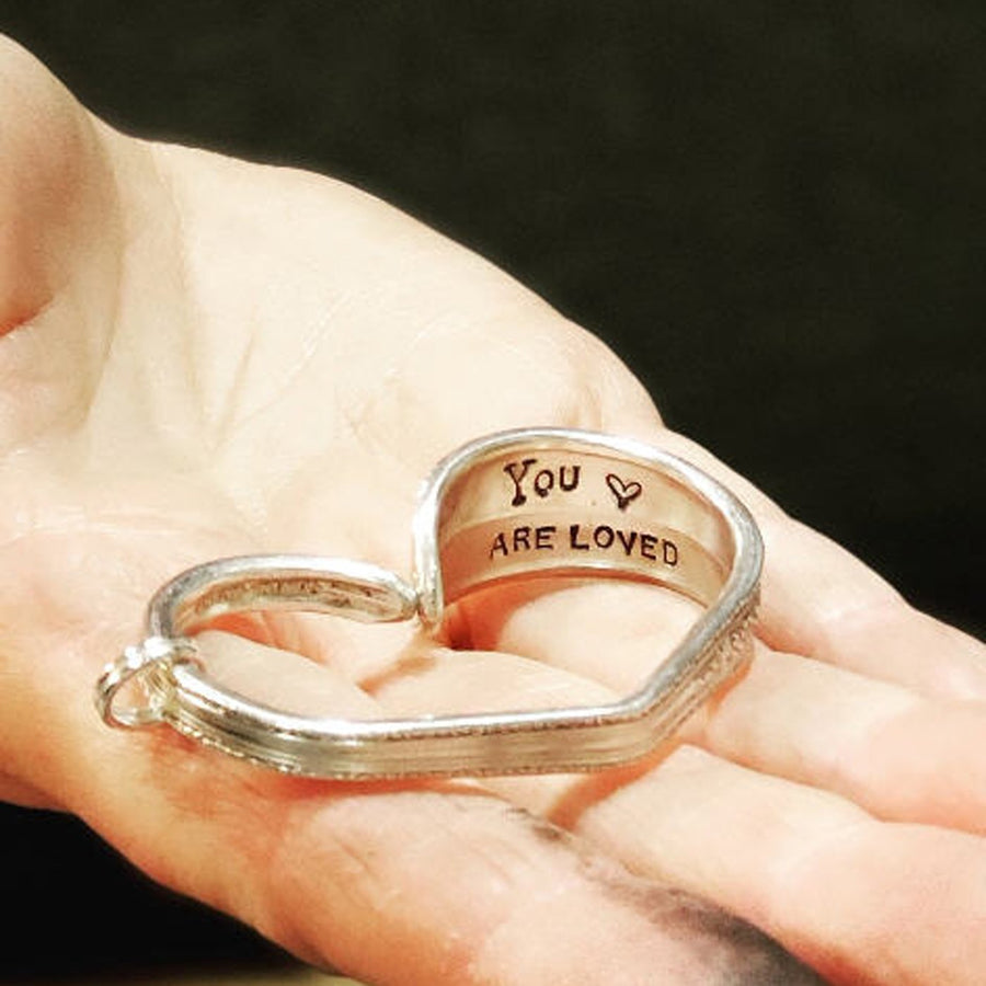 Silver Plate Heart hand stamped with YOU ARE LOVED inside -
