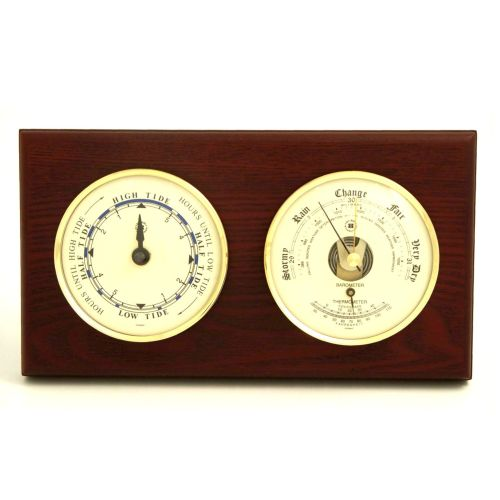 Tide Clock & Barometer With Thermometer On Mahogany Wood