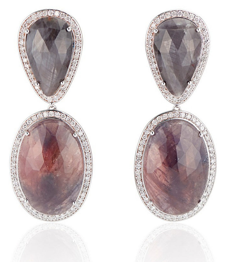 One Of A kind  Sapphire slice earring - blue grey hue  pear shape combined with blue grey and red hue of the oval slices.  They are set in 14 k rose gold with a halo of sparkling diamonds.