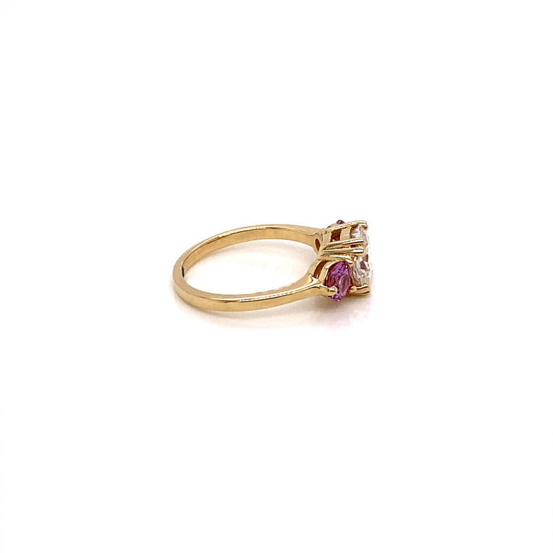 Three-Stone rings features  Cushion Cut Moissanite and two natural round pink sapphires