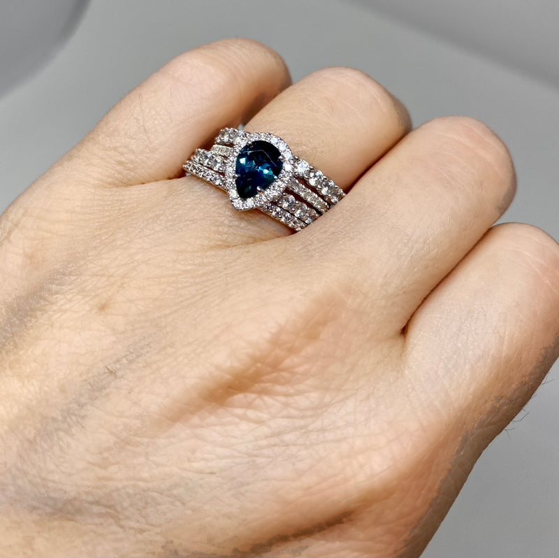 18K White Gold Diamond Halo Teardrop Montana Sapphire Ring stacked with diamond wedding bands  - on model