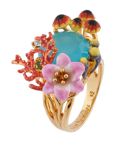 les néréides corals, aquatic mushrooms and flowers on faceted glass ring