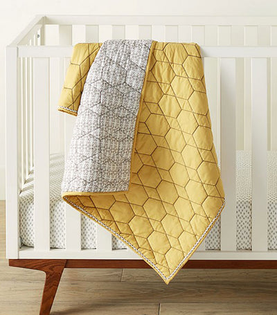 west elm x pbk honeycomb toddler quilt - horseradish