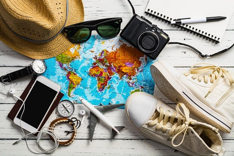 Overhead view of Traveler's accessories, Essential vacation items