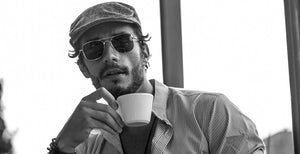 Beautiful Man Drinking a Coffee Cup; Wearing Retro Sunglasses Square Double Bridge in Black & Black Color