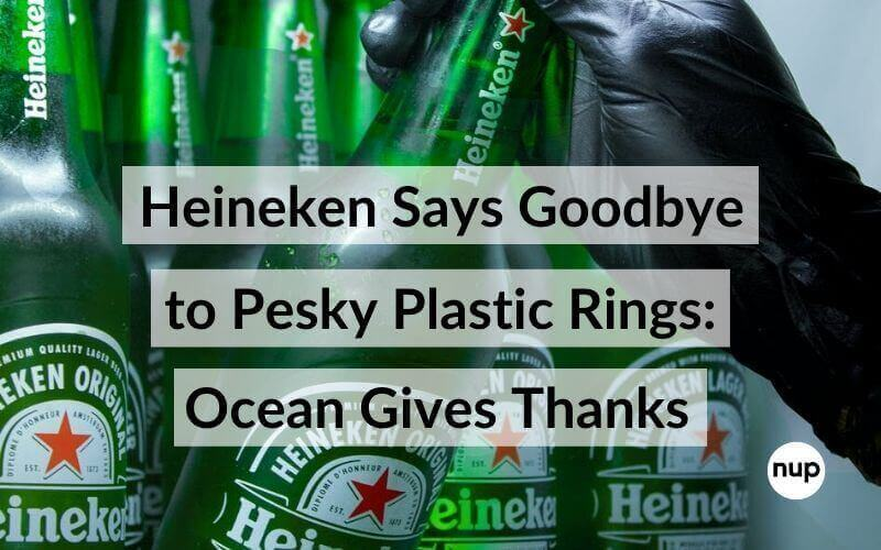Displayed green bottles of heineken and a black glove worn on a hand taking one of the bottles black text with white background white nup logo