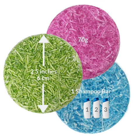 Image of three coloured shampoo bars showing the size and weight