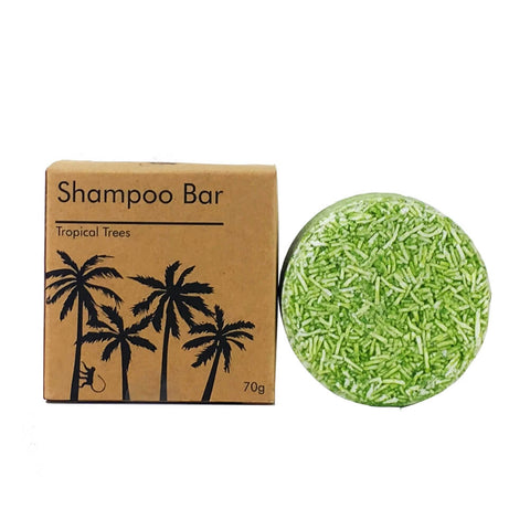 Image of green shampoo bar with brown packaging next to it