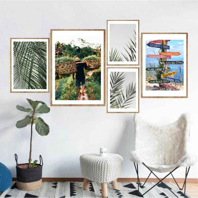 Living room wall gallery of 3 tropical leaves  and 2 Asia themed wall art prints.