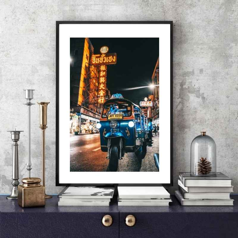 Wall art print of a tuktuk parked at night on a street in Bangkok.