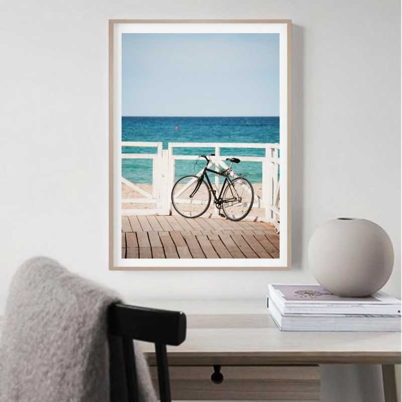 Wall art print of a bicycle on a beach harbour