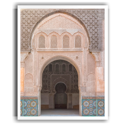 wall art print of an intricately carved and tiled Moroccan archway.