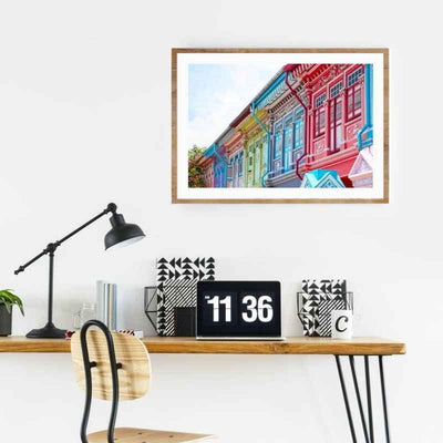 Home office with a framed Wall art print of the famous Joo Chiat shop houses.