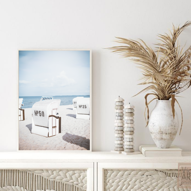 Wall art print of a beach with lounge chairs