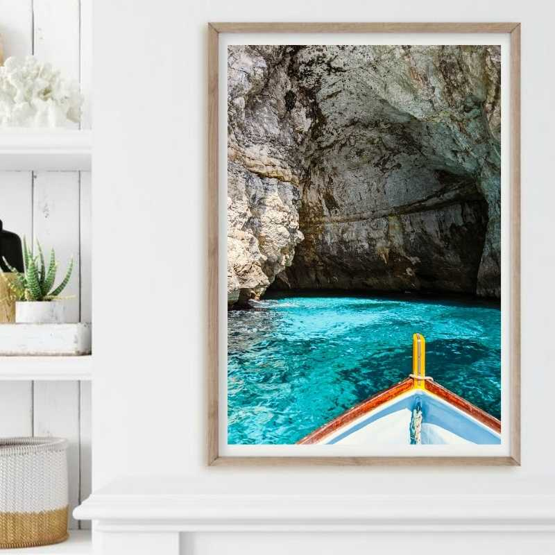 An art print of a boats hull as it is about to enter the blue grotto