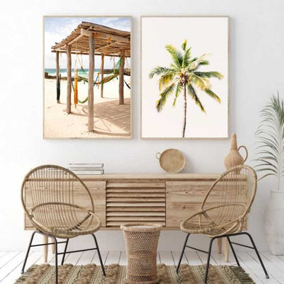 2 framed beach themed wall prints in the living room.