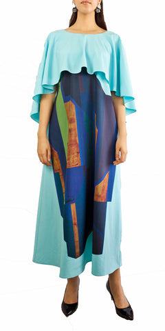 Turquoise maxi dress with wide neckline ruffle and abstracts images of artist Blandino