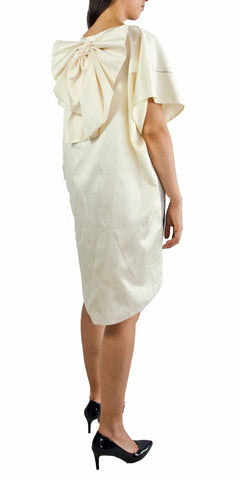 Cream color mini high low dress with statement bow and images of artist Lara Hidalgo