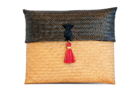 Chocolatillo clutch handbag with pink tassel and pineapple accent
