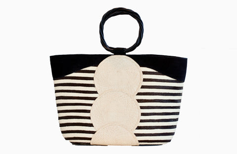 Straw tote in black and white with leather accents and wood handle