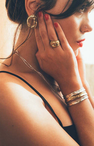 Silver and brass jewelry by Dos Pinceles Puerto Rico