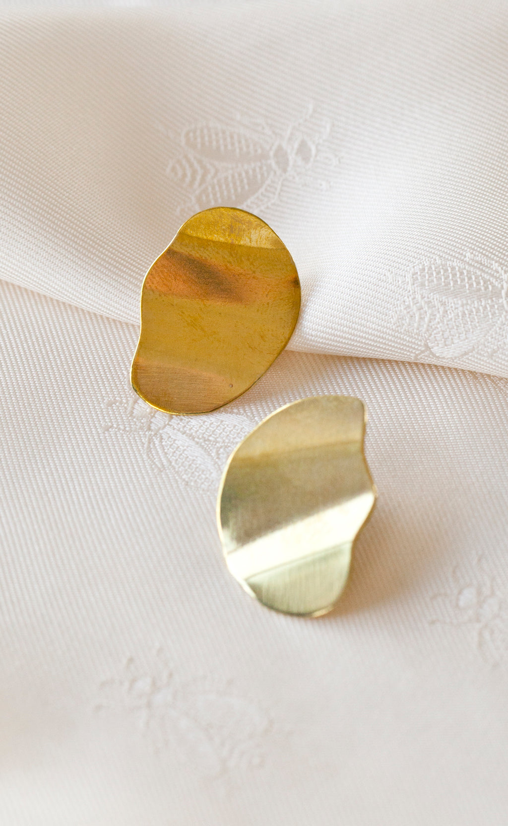 Bronze stud earrings in oval rippled shape hand made in Puerto Rico