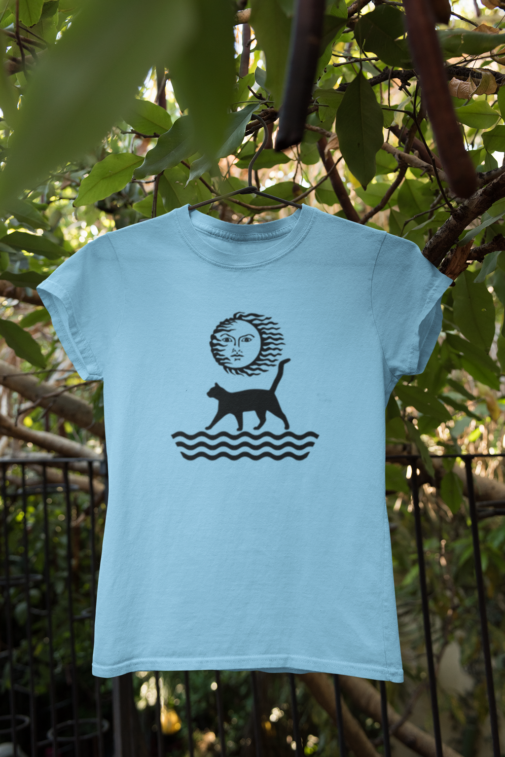 Powder blue organic cotton graphic T-shirt with image of cat and sun
