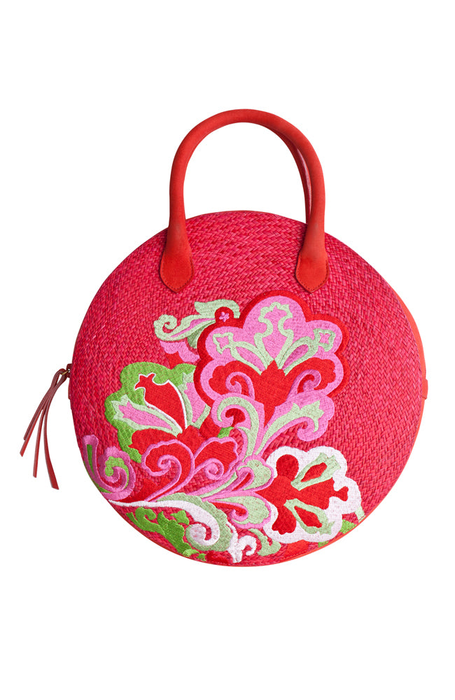 Hand crafted handbag made with Iraca palm fiber, nubuck leather and silk thread embroidery. Intricate colorful flower pattern embellish this very stylish and beautiful creation made by local artisans and designer. Eco conscious fashion.