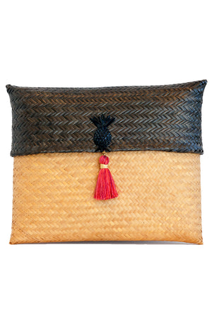 Handcrafted dark brown and cream color straw envelope clutch handbag with pink tassel.