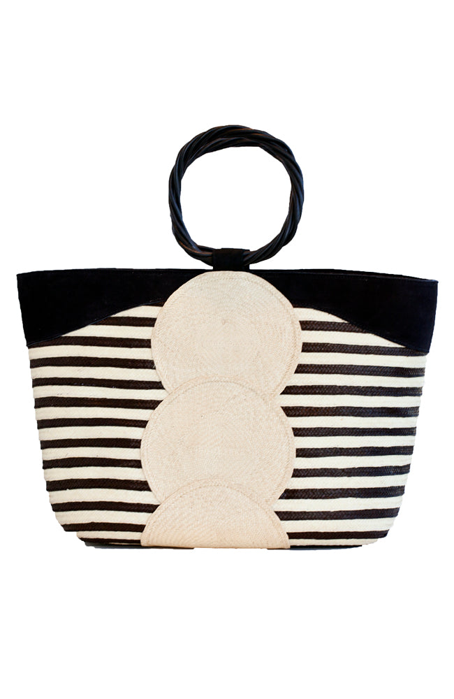 Handmade artisan black and natural straw and leather tote with twisted wood handle.  Sustainable and eco conscious.
