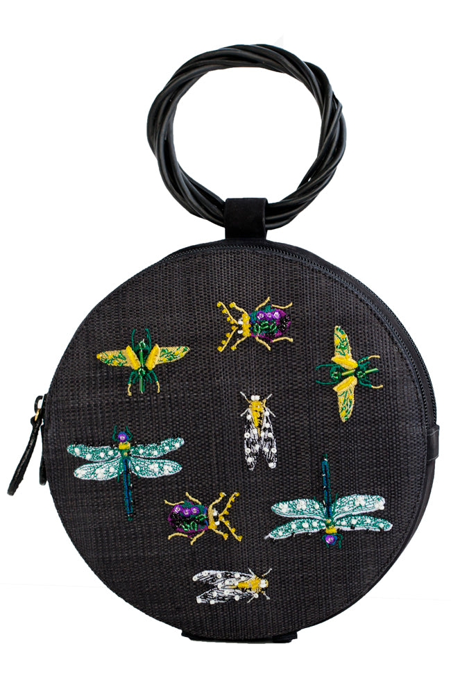 Black straw mini handbag with colorful insect beaded embroidery and rounded wood handle.