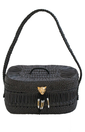 Black straw basket style handbag with 24K gold plated bronze puma accent and glass beads. Intricately woven in a modern design.  Handmade by Colombian artisans in eco friendly and sustainable manner.