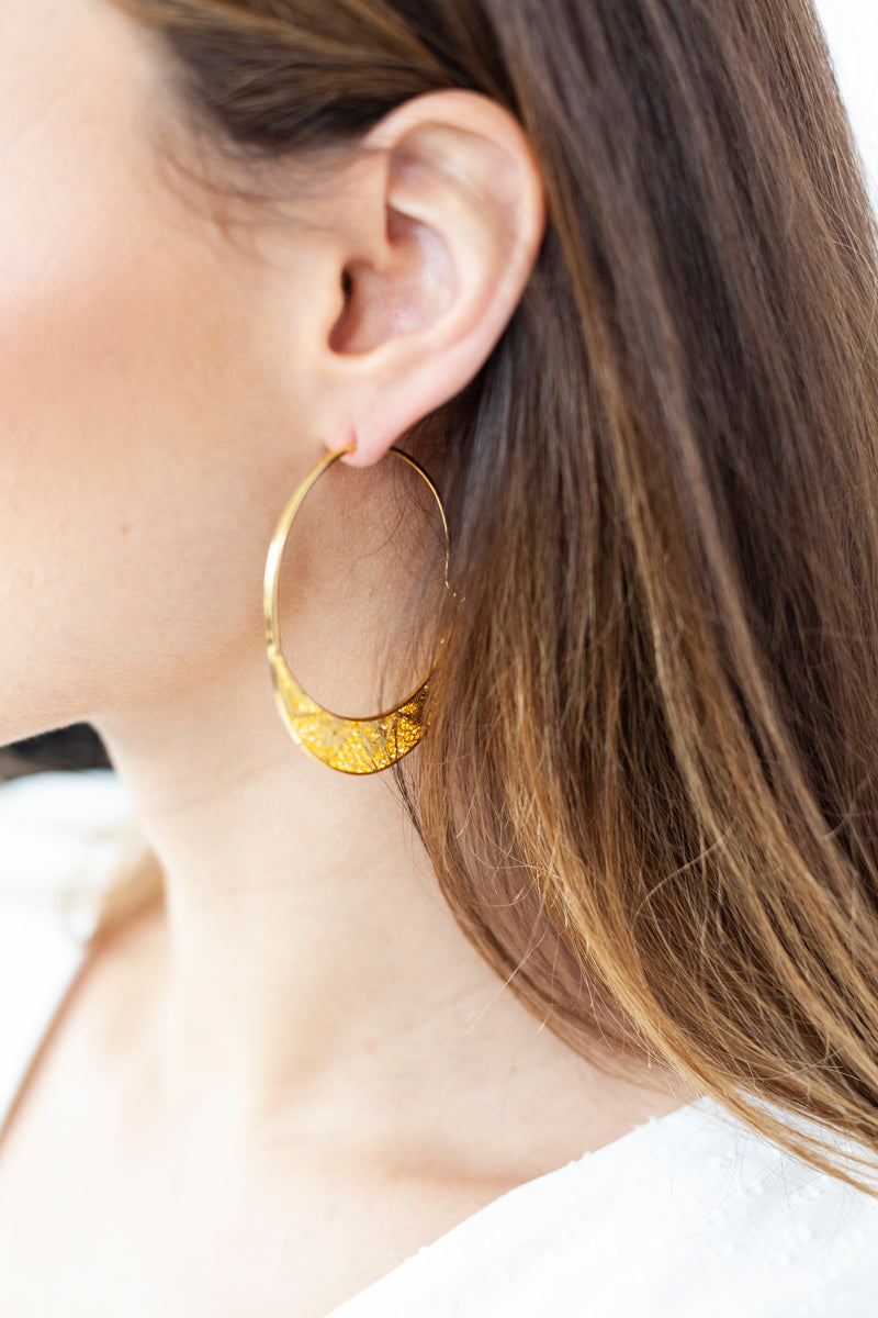 Gold large hoop earrings with filigree pattern handmade in Colombia