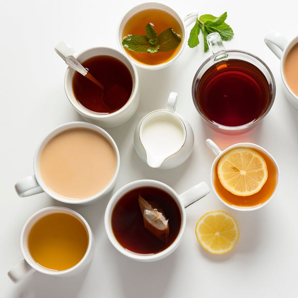 Seven tea cups filled with brewed tea, including mint, black, citrus, and herbal teas; Photo by Joanna Kosinska on Unsplash