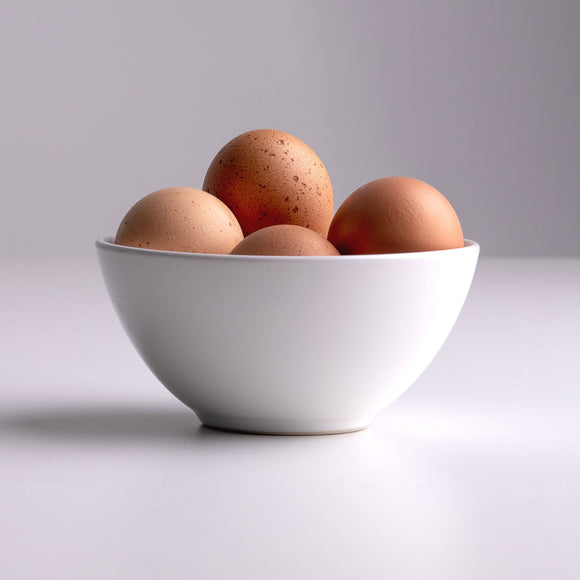 Bowl of eggs sitting on table; Photo by Elliot Banks on Unsplash