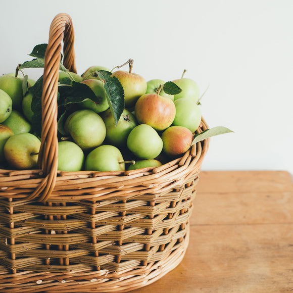 Basket of apples sitting on a table; Photo by Annie Spratt on Unsplash