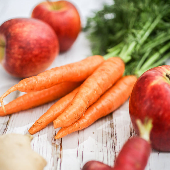 Carrots and Apples; Photo by Kristen Kaethler on Unsplash