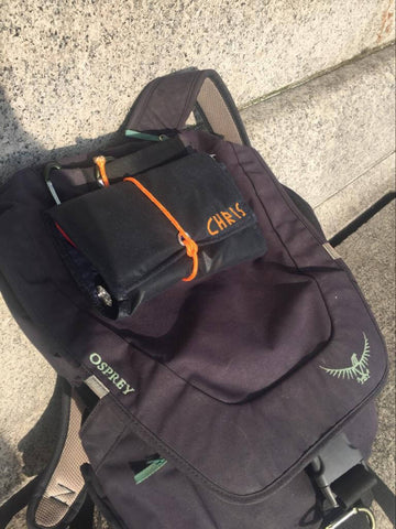 First Savvy Travel pack clipped onto the outside of a daypack