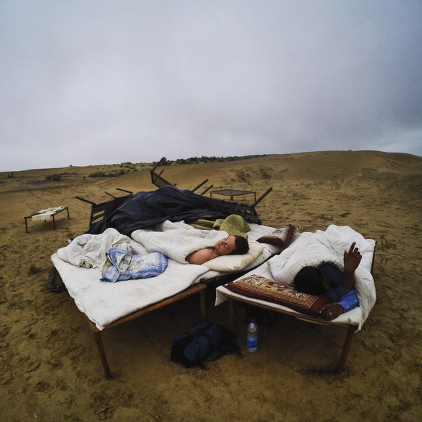 Because we had no waterproof poncho we had to sleep under a huge tarpaulin in the desert