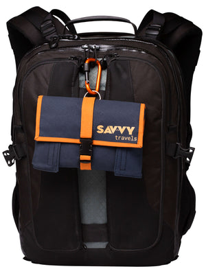 Kilimanjaro Savvy Travel Pack attached to a backpack via its screw lock carabiner