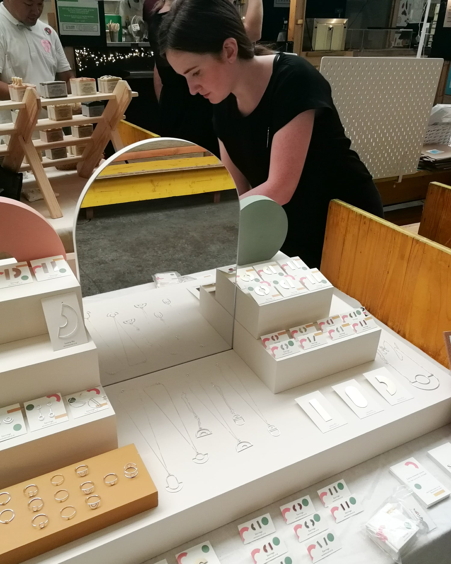 Searlait from Today jewellery setting up craft fair display at Crafty Fox in London