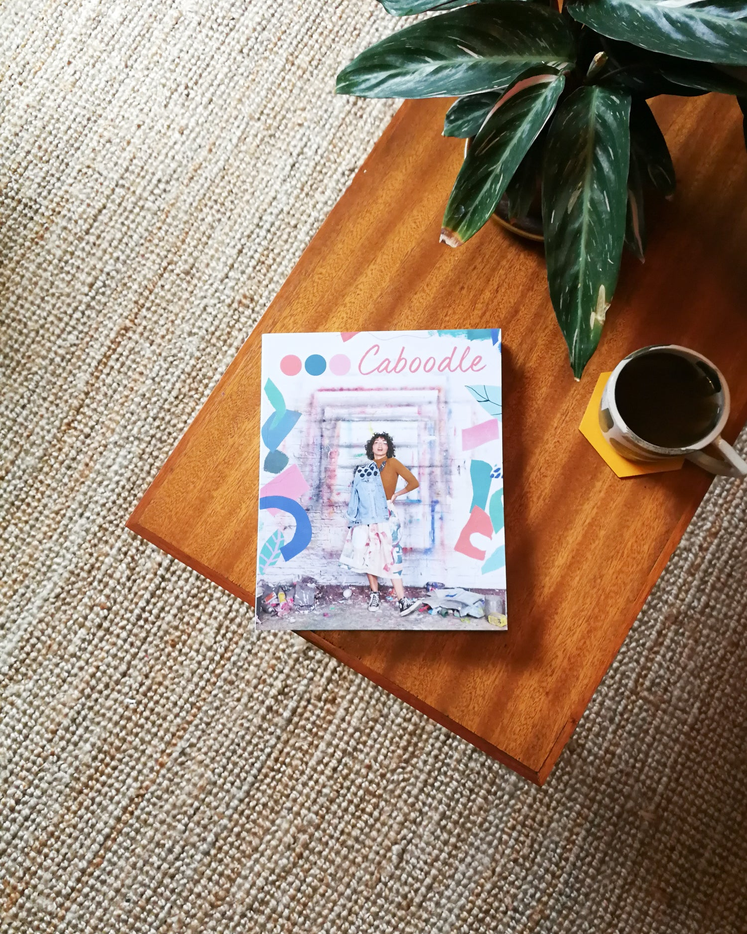 Caboodle Magazine on a coffee table