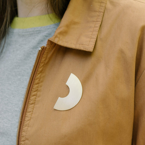 Oversized arc pin badge in brushed brass