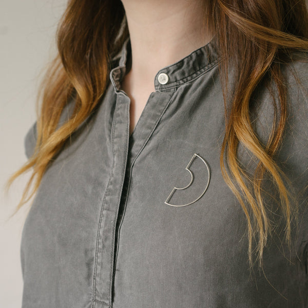Delicate arc shaped recycled silver brooch
