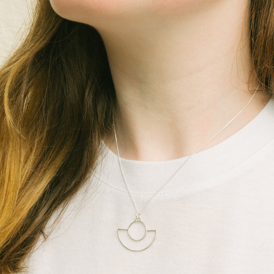 Art Deco inspired delicate eco silver necklace on model