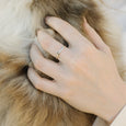 Simple eco silver dot ring on hand with fur