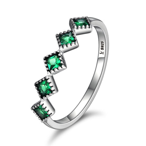 green light rhodium ring
