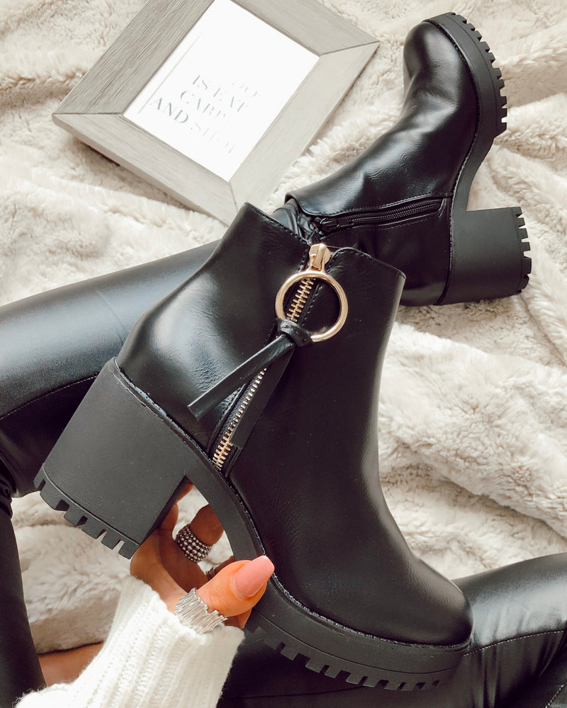 open options black chunky tassel boots
